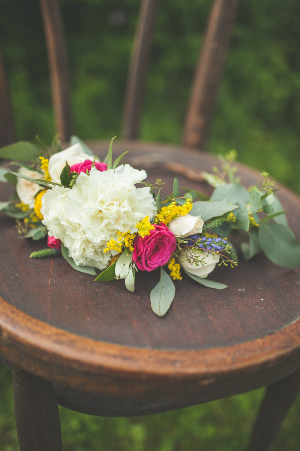 pink yellow and white floral floral crown by St. Charles Florist