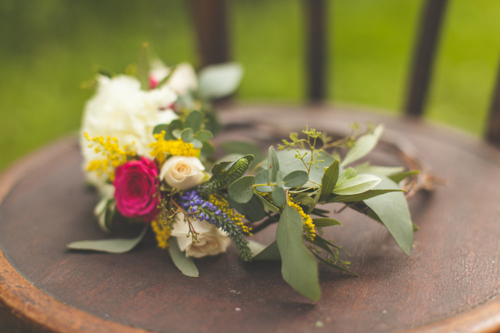 pink yellow and white floral crown by St. Charles Florist