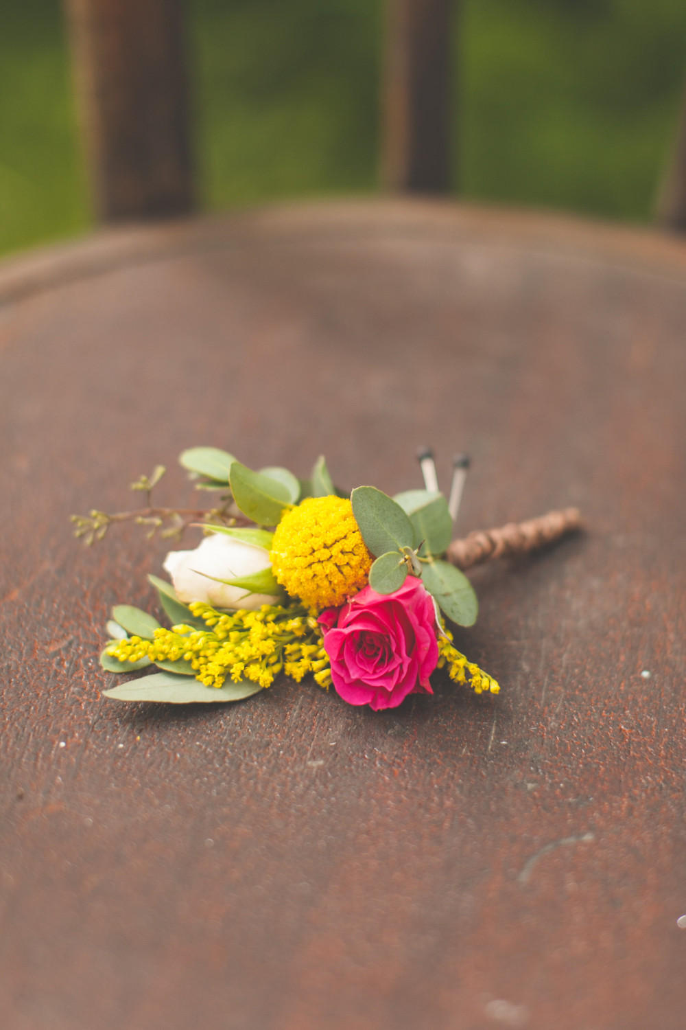 pink yellow and white boutonniere by St. Charles Florist