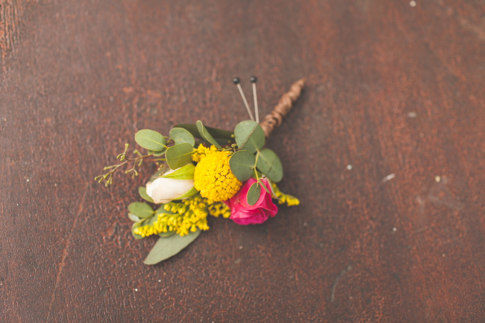 pink yellow and white boutonniere
