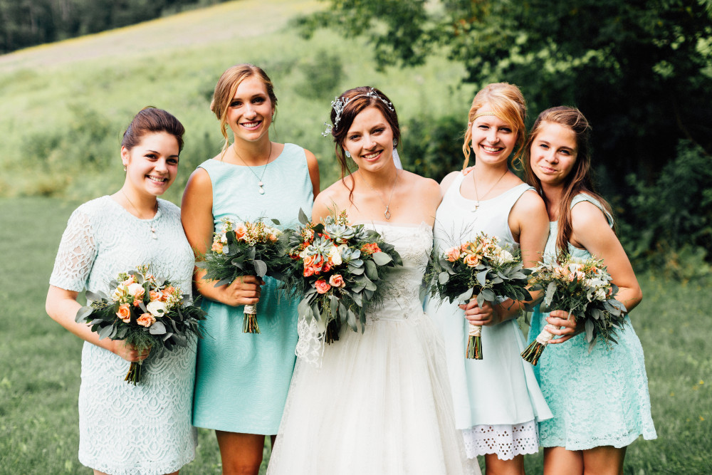 Blue, white, pink, and green wedding flowers