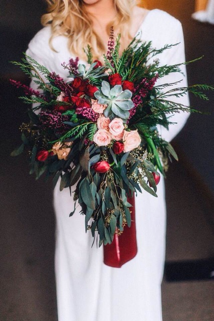 burgundy, pink, green, and red floral bridal bouquet