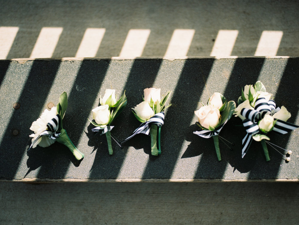 boutonnieres with black and white ribbon by Saint Charles, Illinois florist