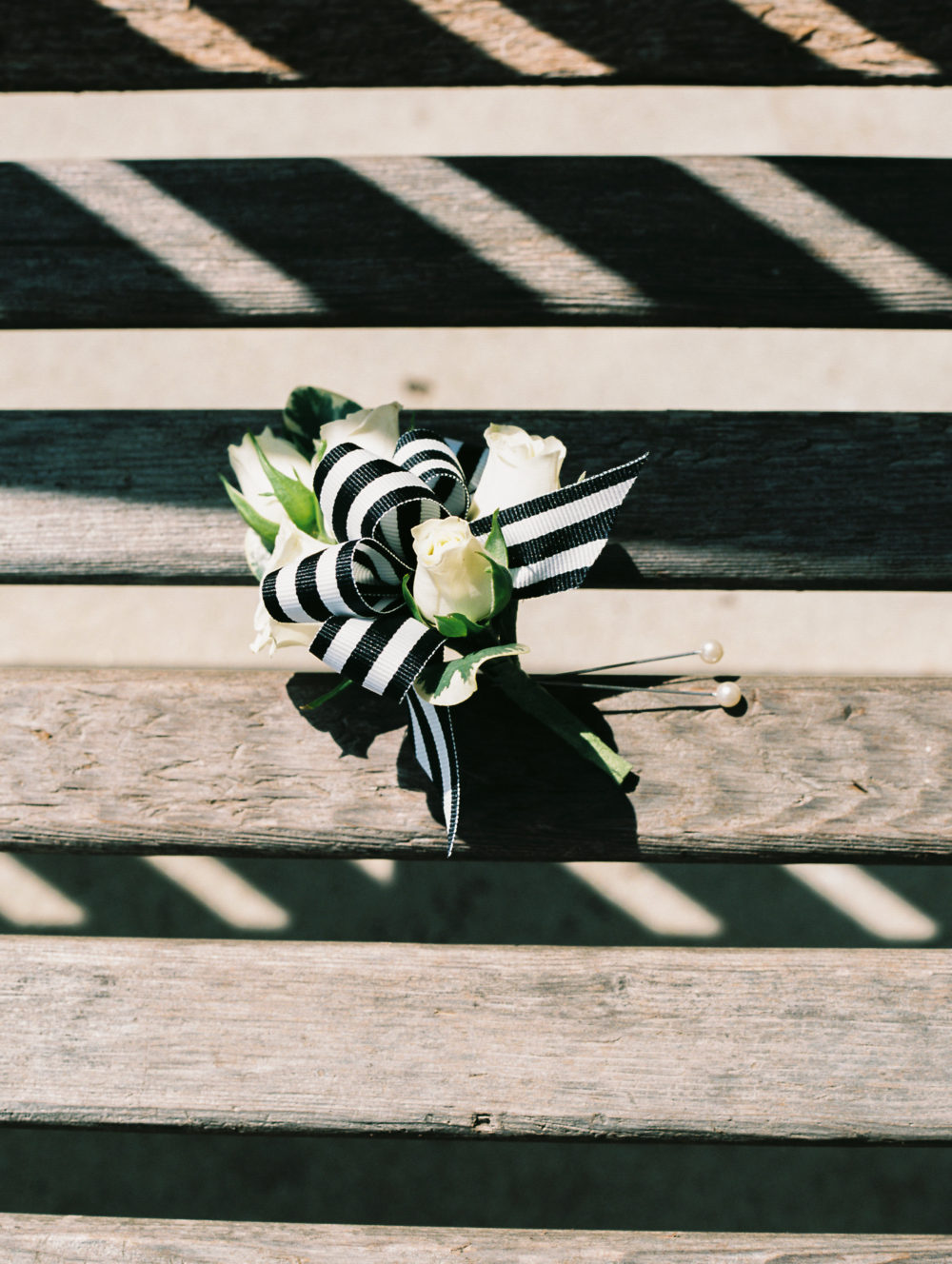 boutonniere with black and white ribbon by Saint Charles, Illinois florist