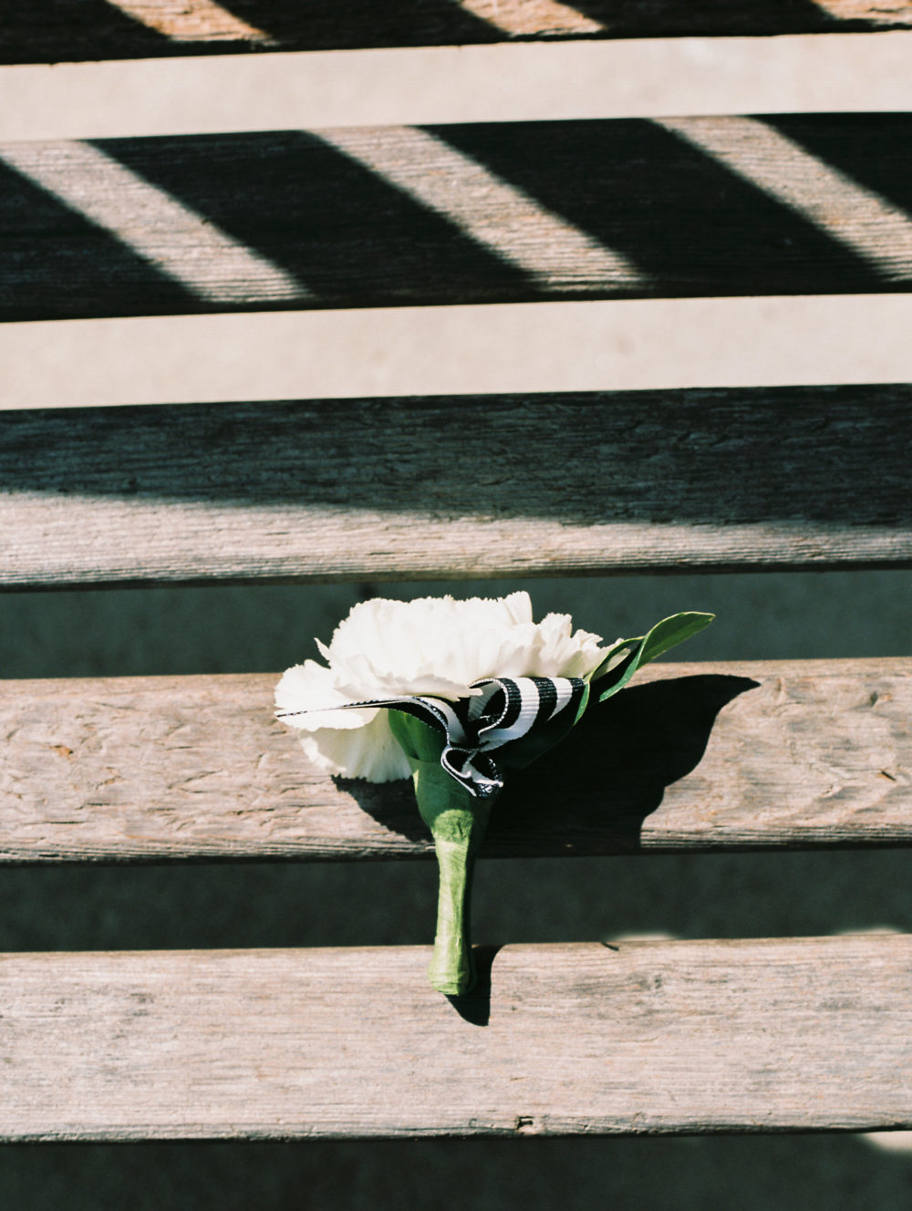 groom's boutonniere with black and white ribbon by Saint Charles, Illinois florist