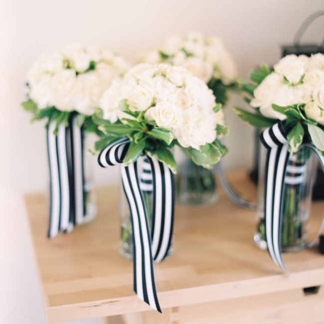 White bridesmaid bouquets with black and white ribbon