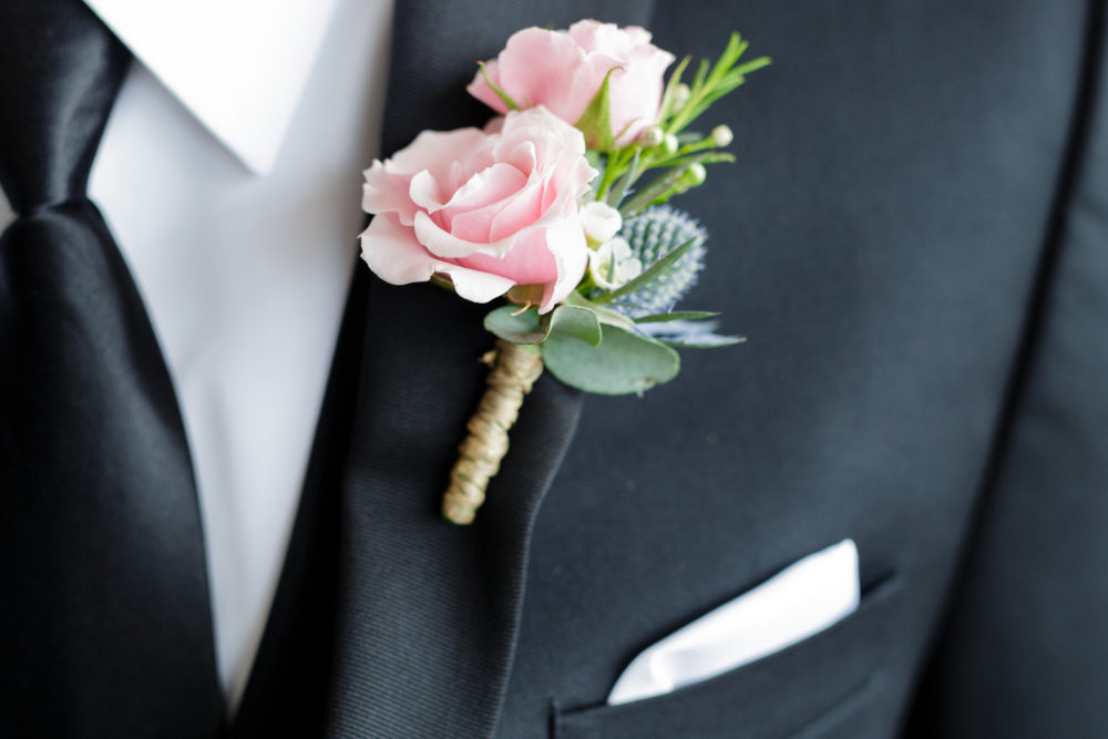 pink-rose-boutonniere-with-thistle-for-groom-chicago-illinois